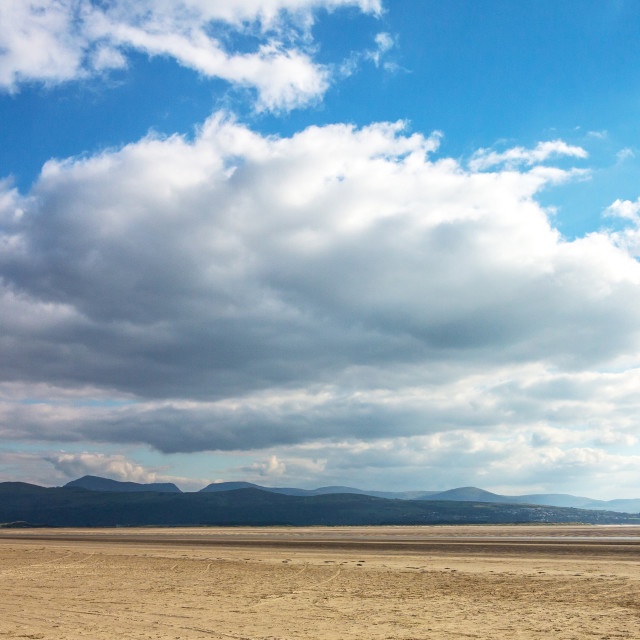 """""""Clouds,Beach and Mountains"""" stock image"""