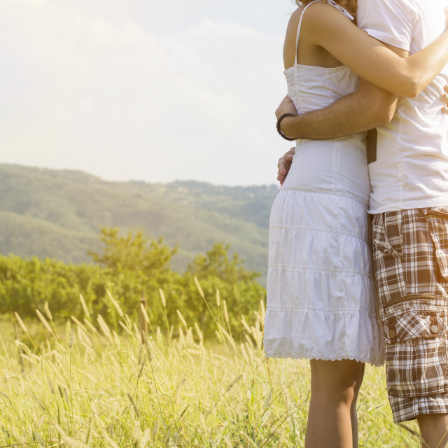 """Loving couple hugging strong outdoors with no faces shown"" stock image"