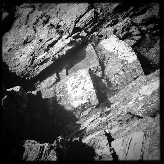 """A black and white rock face"" stock image"