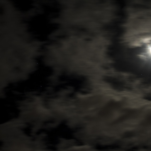 """""""Moon, moving clouds and star scape"""" stock image"""