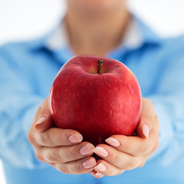 """Healthy eating concept. Business woman holding red apple in his"" stock image"