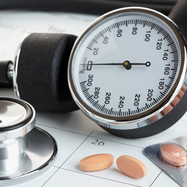 """""""Tablets and Blood Pressure Meter on a Calendar"""" stock image"""