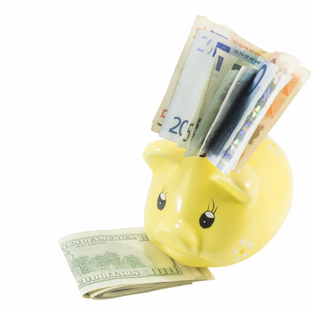 """Euro and USA dollar bills in the piggy bank isolated"" stock image"