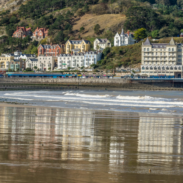 """Reflections in the Sand at Llandudno"" stock image"