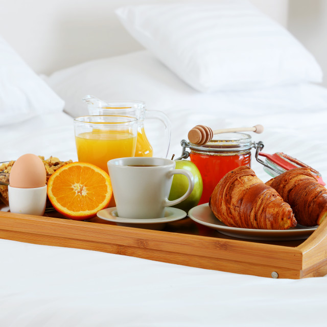 """Breakfast in bed in hotel room."" stock image"