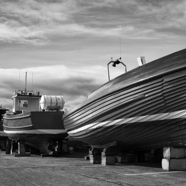 """""""Boats hauled out for winter - monochrome."""" stock image"""