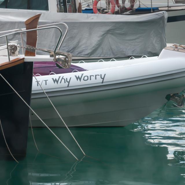 """""""Port Adriano marina. Why Worry small boat anchored in Port Adriano marina."""" stock image"""