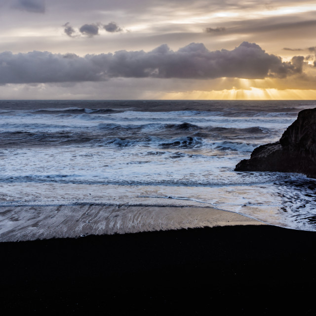 """Black sand beach sunrise"" stock image"