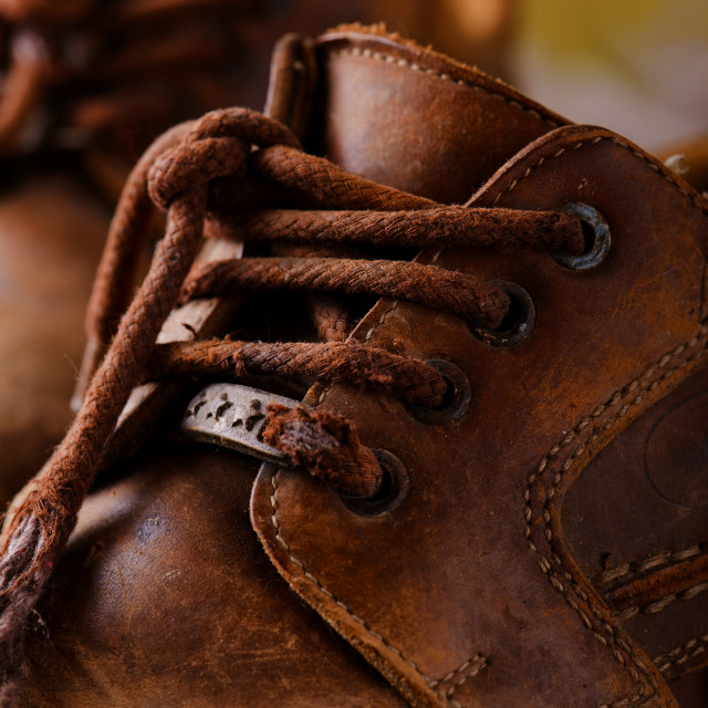 """""""Detail of very old shoelaces on leather boots"""" stock image"""