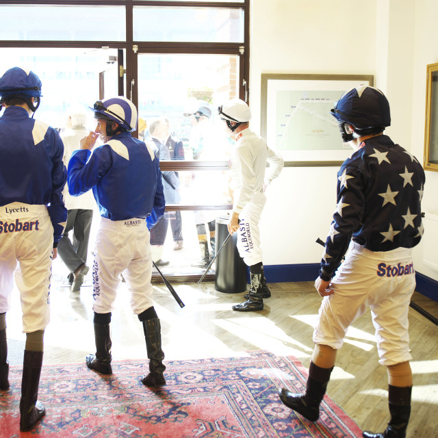 """Jockeys leave the weighing room"" stock image"