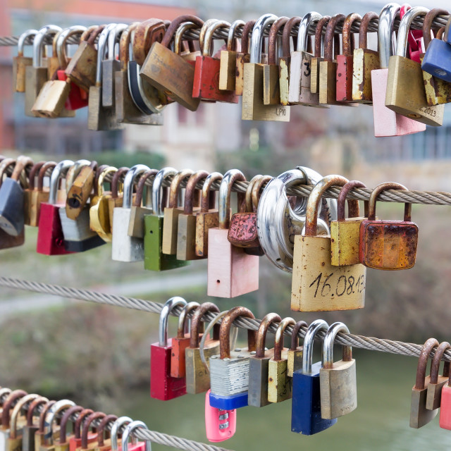 """Love padlocks hanging from railing on bridge"" stock image"