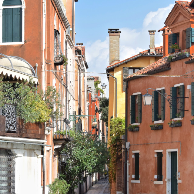 """Small stone street in Venice, Italy"" stock image"