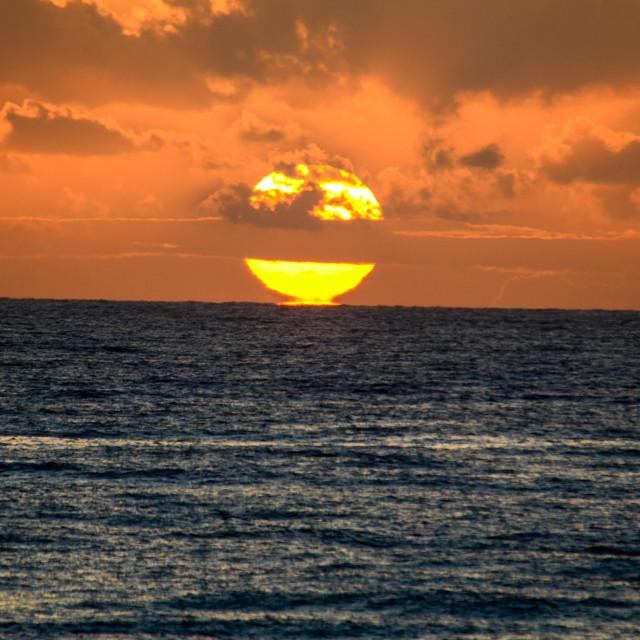 """Sun kiss sea"" stock image"