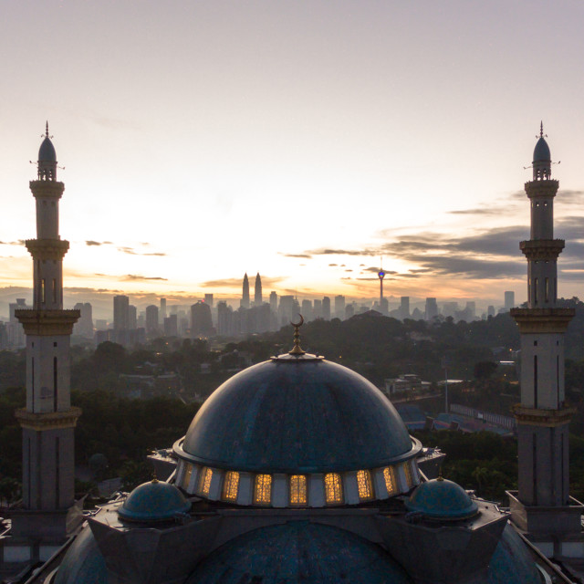 """Silhouette mosque and Kuala Lumpur city skyline"" stock image"