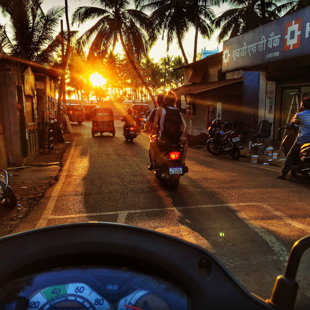 """Scooter driving in Goa"" stock image"