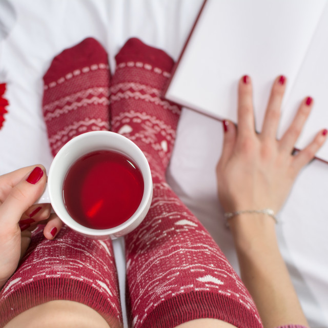 """Woman having a cup of tea in bed"" stock image"