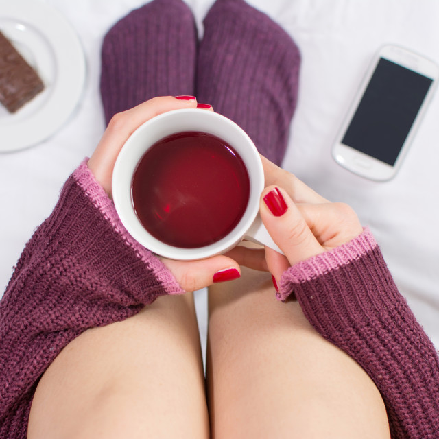 """""""Woman having a cup of tea in bed"""" stock image"""