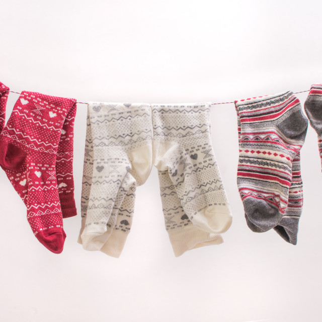 """Various colored socks on a wire"" stock image"