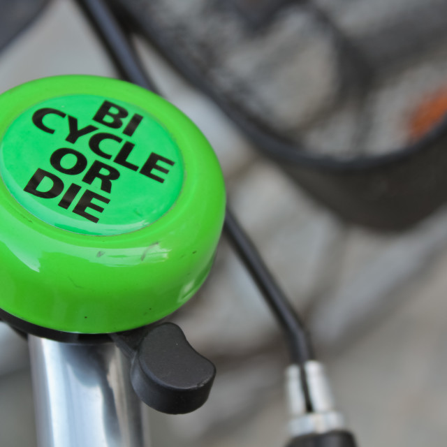 """""""Green bicycle bell with sign"""" stock image"""