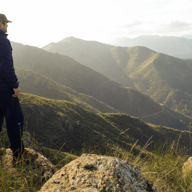 """hiker overlooking mountain range"" stock image"