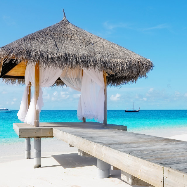 """Overwater hut with palm leaves roof. Maldives"" stock image"
