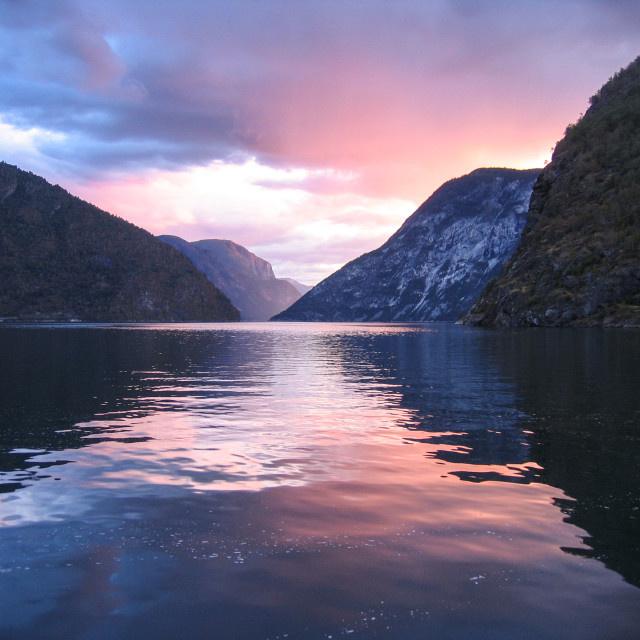 """Norwegian fjords with clouds reflection in water"" stock image"