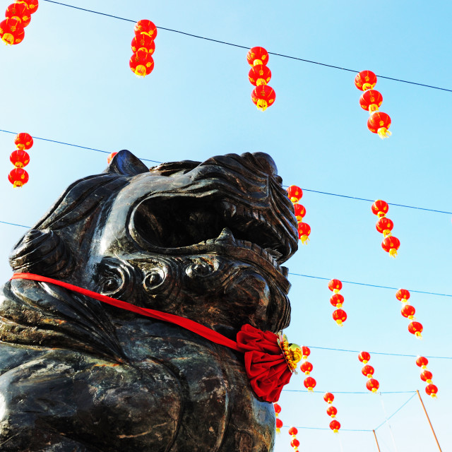 """Chinese temple guardian and lanterns"" stock image"
