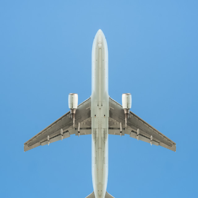 """passenger jet on blue"" stock image"