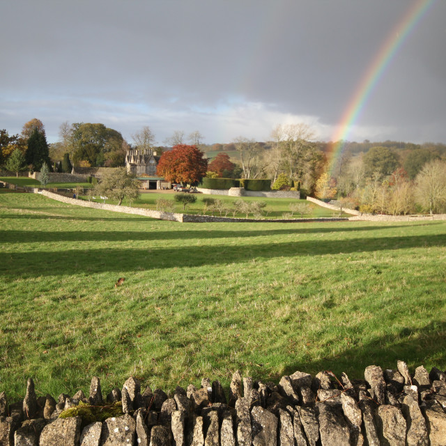 """Manor House, Cotswolds with rainbow"" stock image"