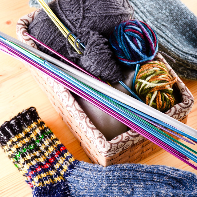 """Box with knitting accessories and pair of socks"" stock image"