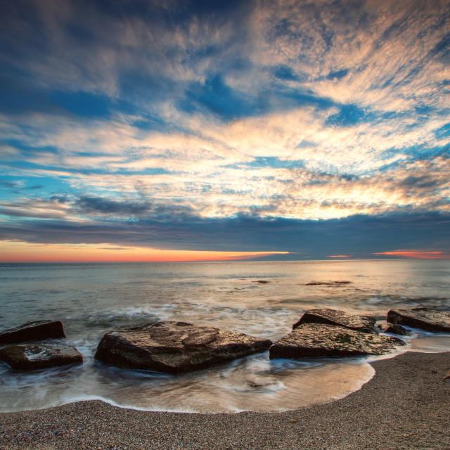 """Beautiful cloudscape over the sea, sunrise shot"" stock image"