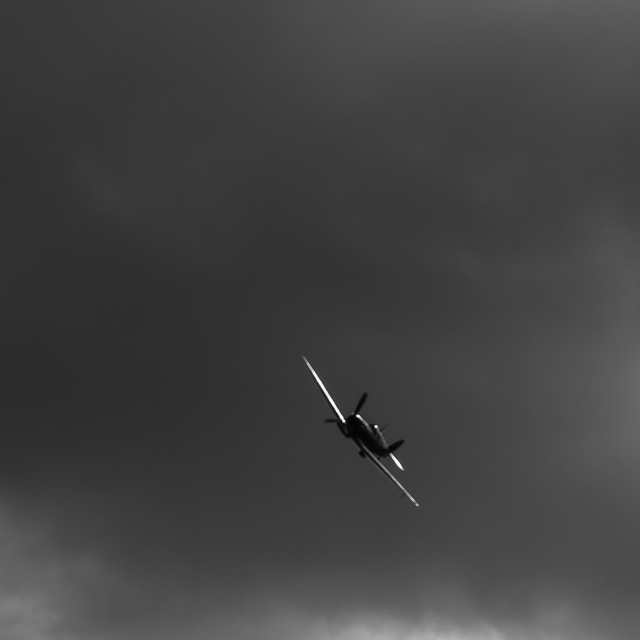 """Spitfire against storm clouds"" stock image"