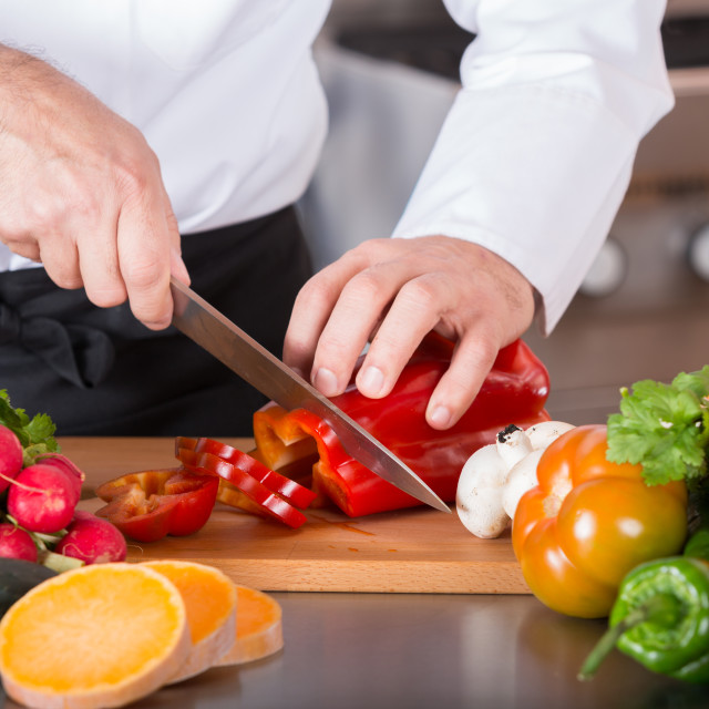 """Chef chopping vegetables"" stock image"