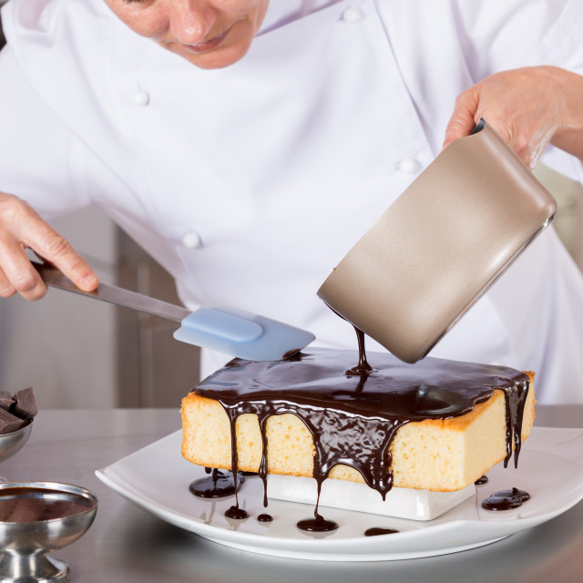 """Pastry chef in the kitchen"" stock image"