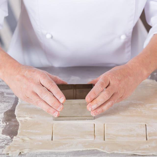 """Baker kneading dough"" stock image"