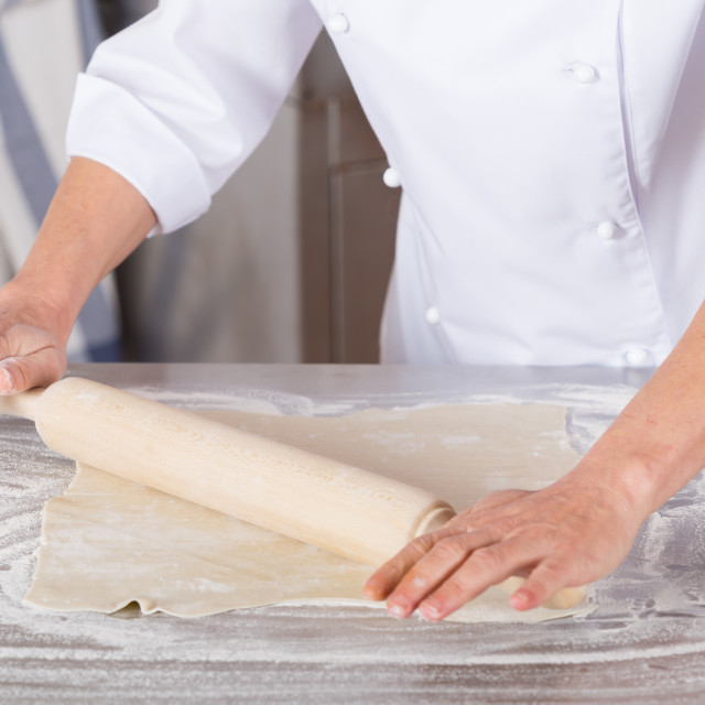 """Baker kneading dough"" stock image"