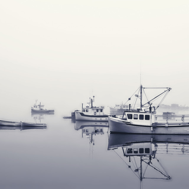 """Fishing boats on misty lake"" stock image"