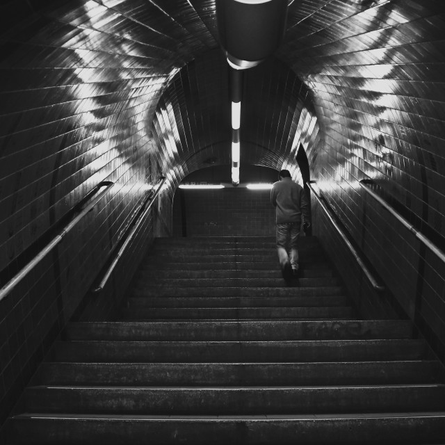 """""""Man climbing the stairs at the subway"""" stock image"""