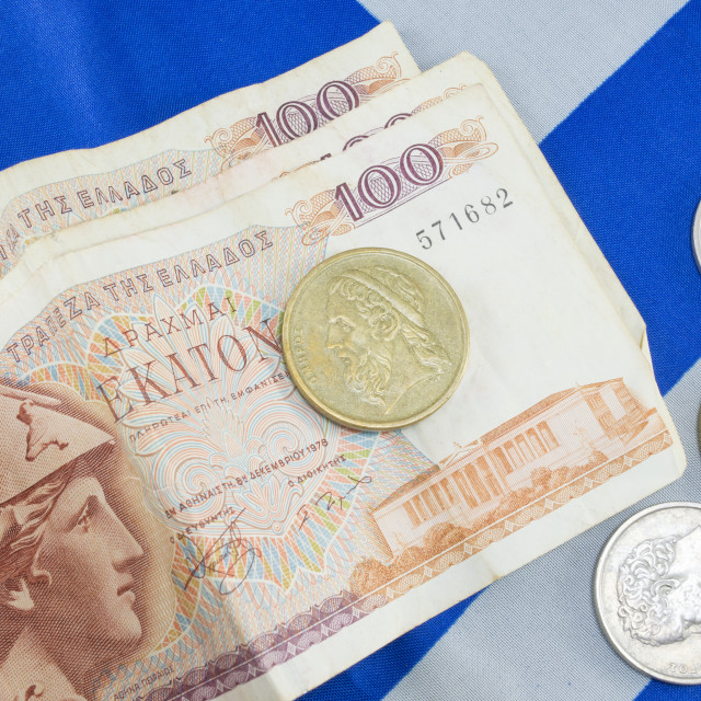 """Greek old currency drachma banknotes on the Greek flag"" stock image"