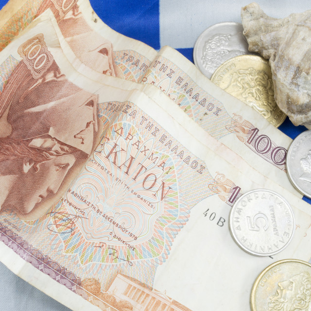 """Greek old currency drachma banknotes and a shell on the Greek fl"" stock image"