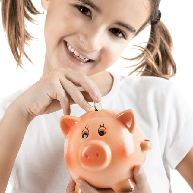 """""""Little girl with a piggy-bank"""" stock image"""