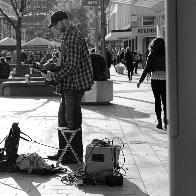 """Busking in town"" stock image"