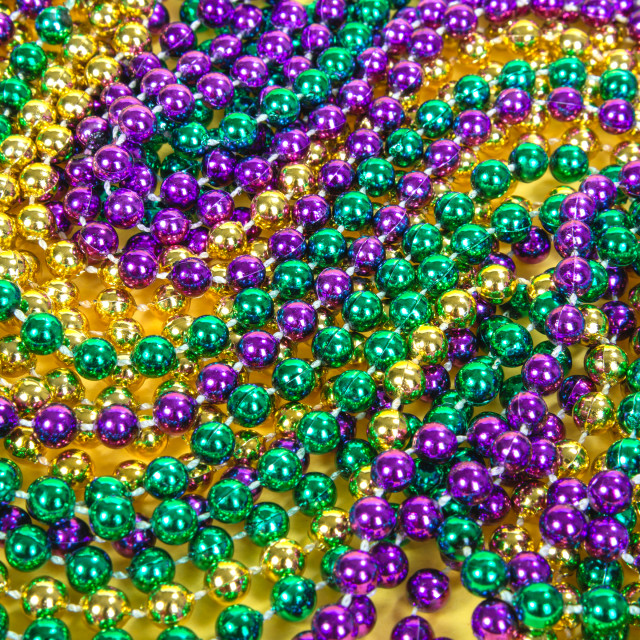 """Colorful Mardi Gras beads background"" stock image"