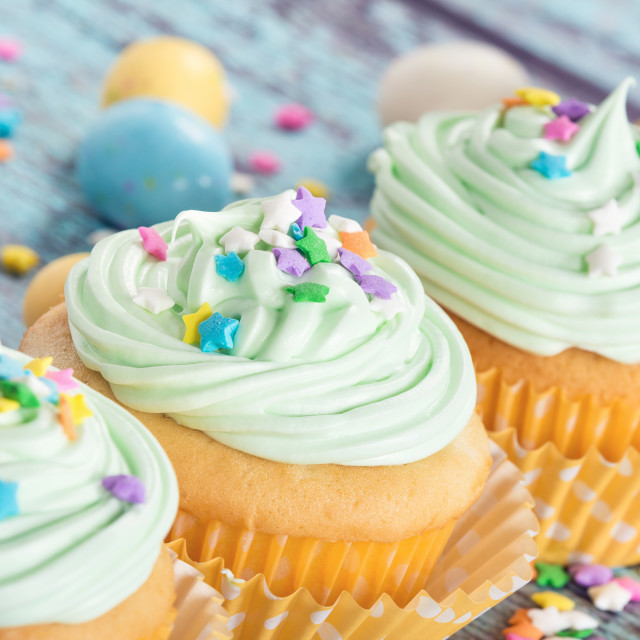 """Pastel Easter cupcakes with candy and sprinkles"" stock image"