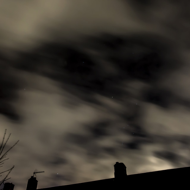 """""""Orion's Belt, Cloud and rooftops 2"""" stock image"""