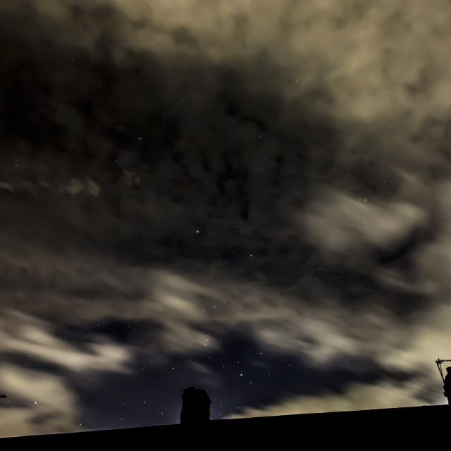 """Orion's Belt, Cloud and rooftops"" stock image"