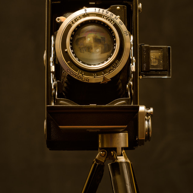 """Old Zeiss-Ikon camera on tripod."" stock image"