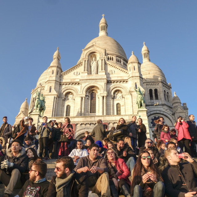 """crowd sitting in front of Sacred Heart Church or Sacre Coeur in Montmartre"" stock image"