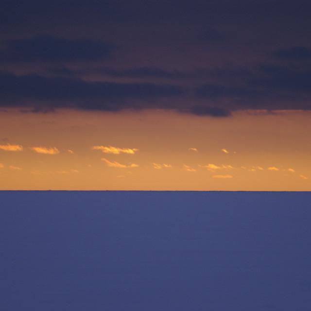 """Sunset over frozen sea"" stock image"