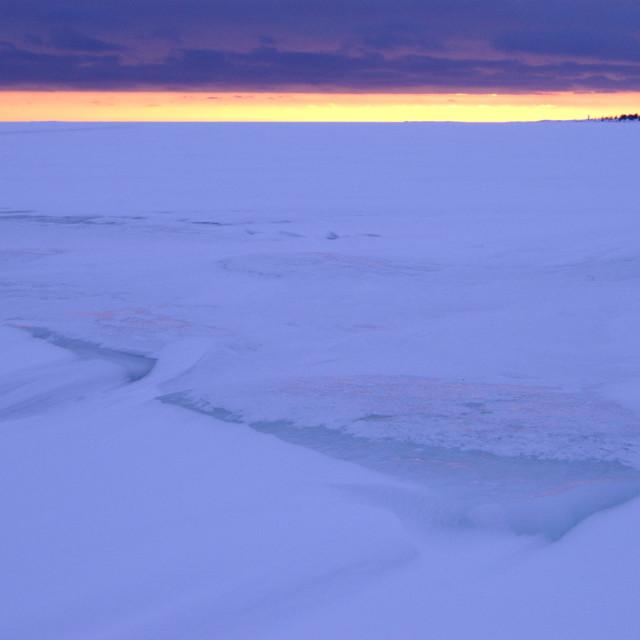 """Winter sunset at sea"" stock image"
